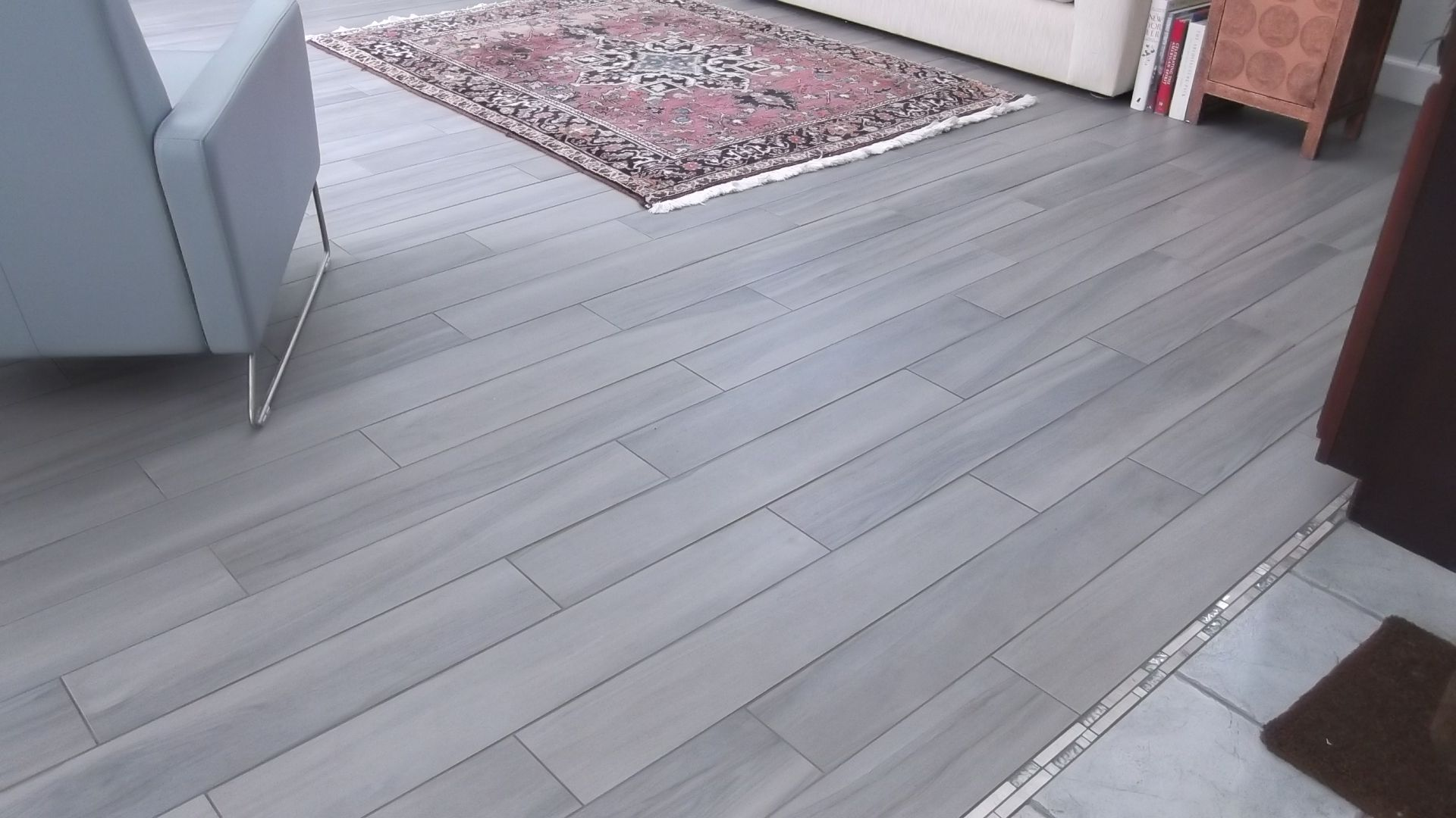 Beautiful grey woodlook tile installed in a customers home our