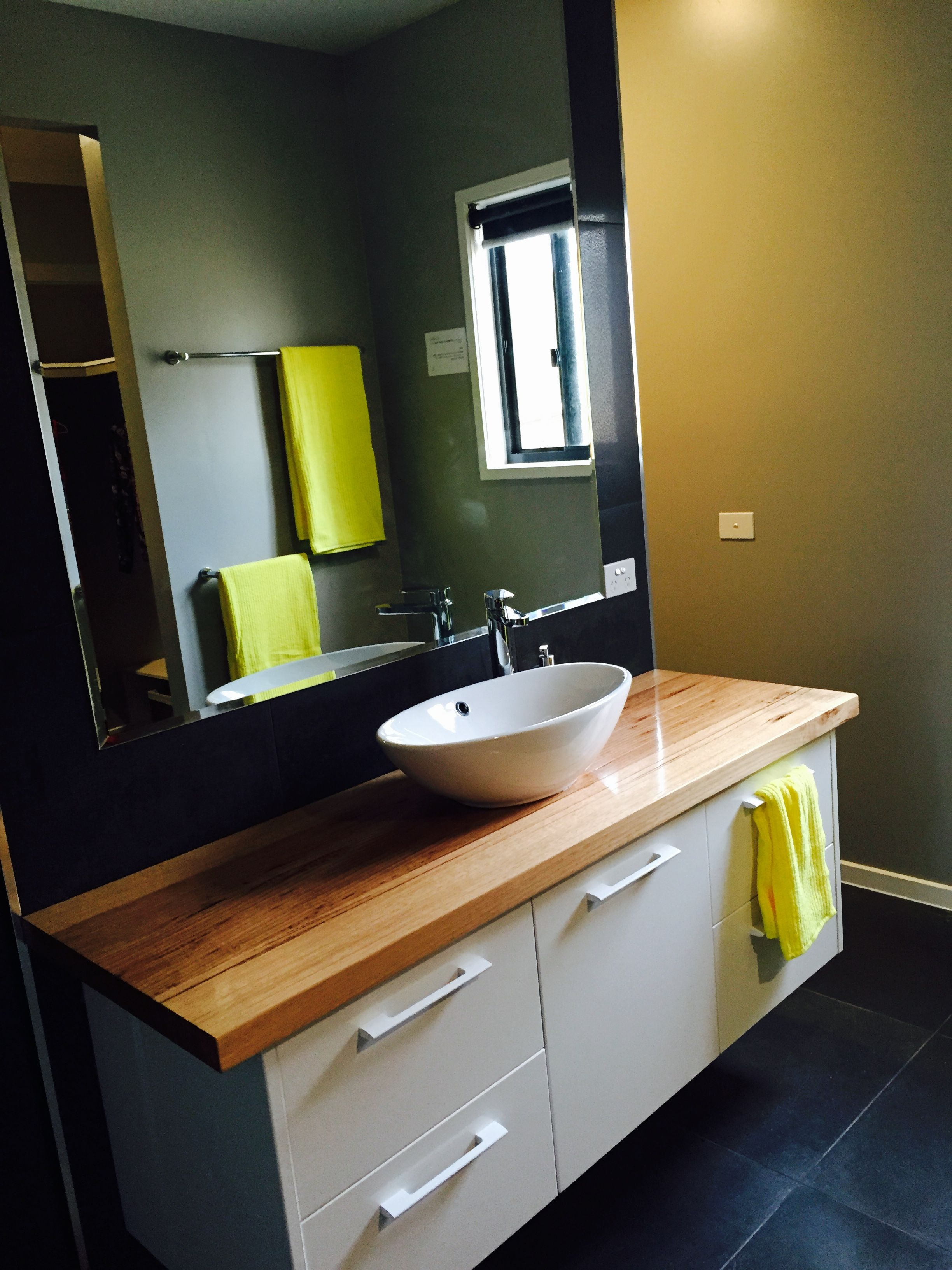 Ensuite bathroom, charcoal tiles, wooden bench top and oval basin ...