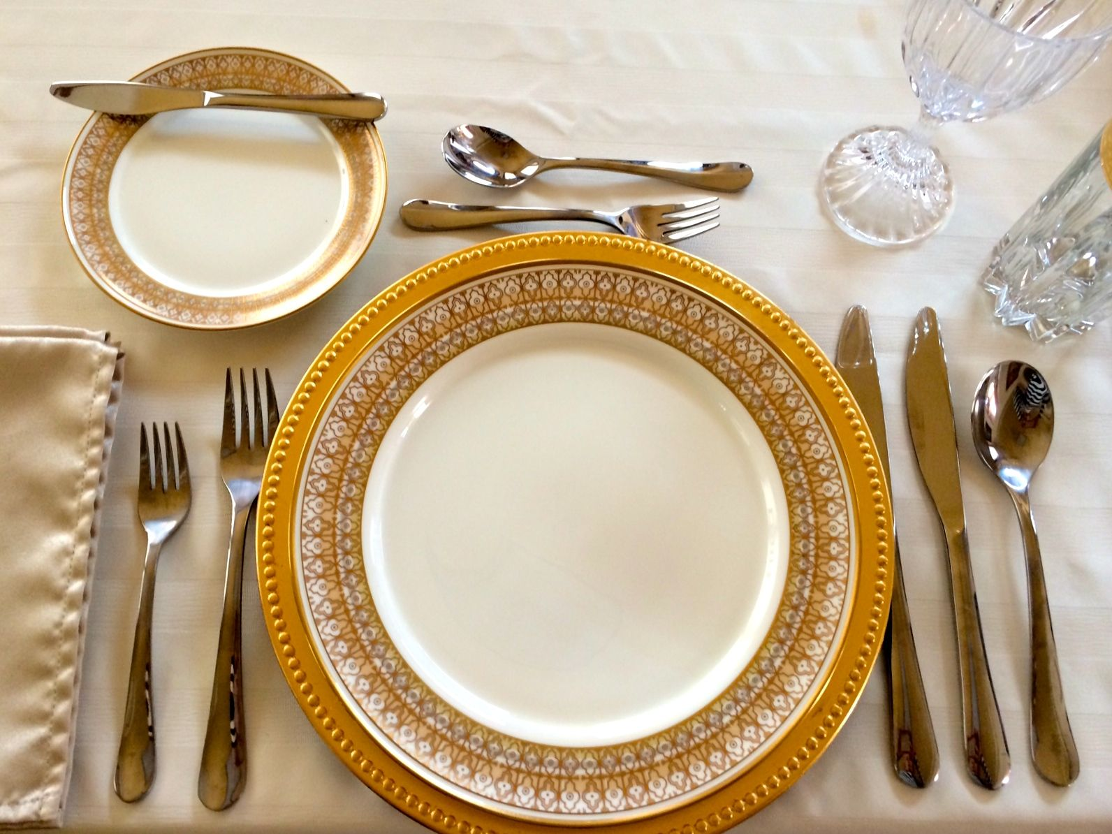 This is a standard and correctly set 4-course table setting. The dinner planned includes a soup course FIRST a salad (which requires cutting) SECOND ... & This is a standard and correctly set 4-course table setting. The ...