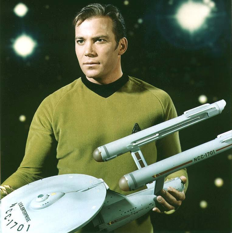 1966 publicity shot of the three-foot studio model of the Constitution-class USS Enterprise held by William Shatner/Captain James Tiberius Kirk
