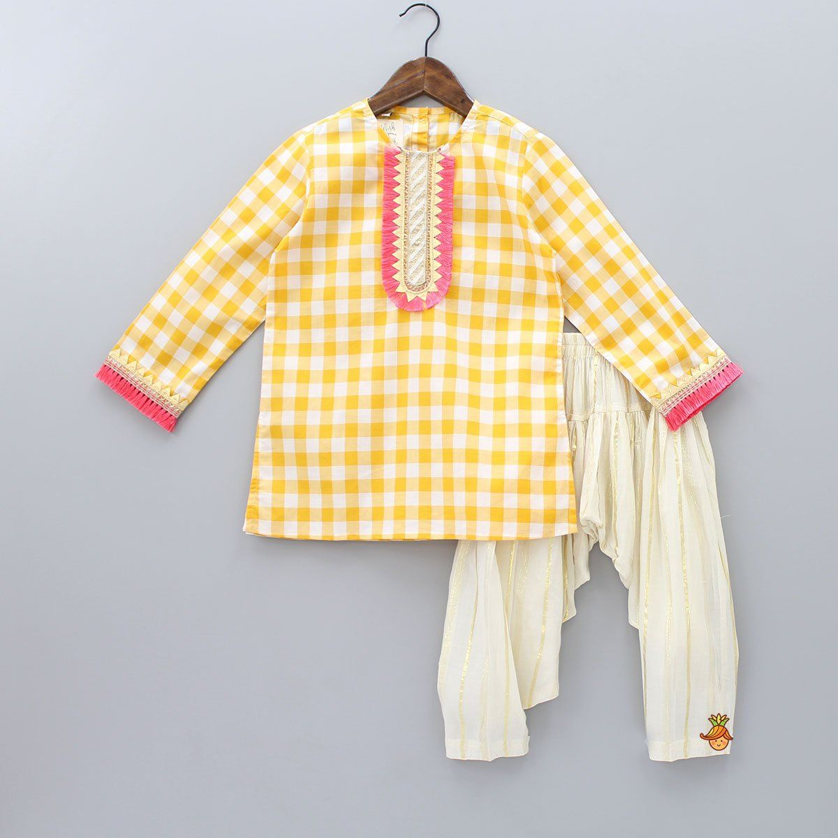 Dhotis & Patialas - Yellow and white kurta with checks print all over, Kurta with tassels and lace attached at yoke and sleeves, Kurta with back button opening, Off-white pataila with golden stripes on it, Patiala with elastic at waist