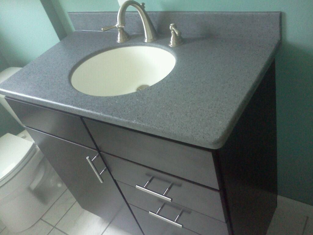 Bathroom Vanity with An Avonite Solid Surface Counter Top An