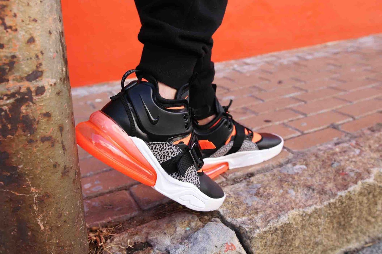 31eef8ab77 A vibrant explosion of colour hits the Air Force 270. The orange colourway  is stamped across the forefoot as well as the ankle surround .