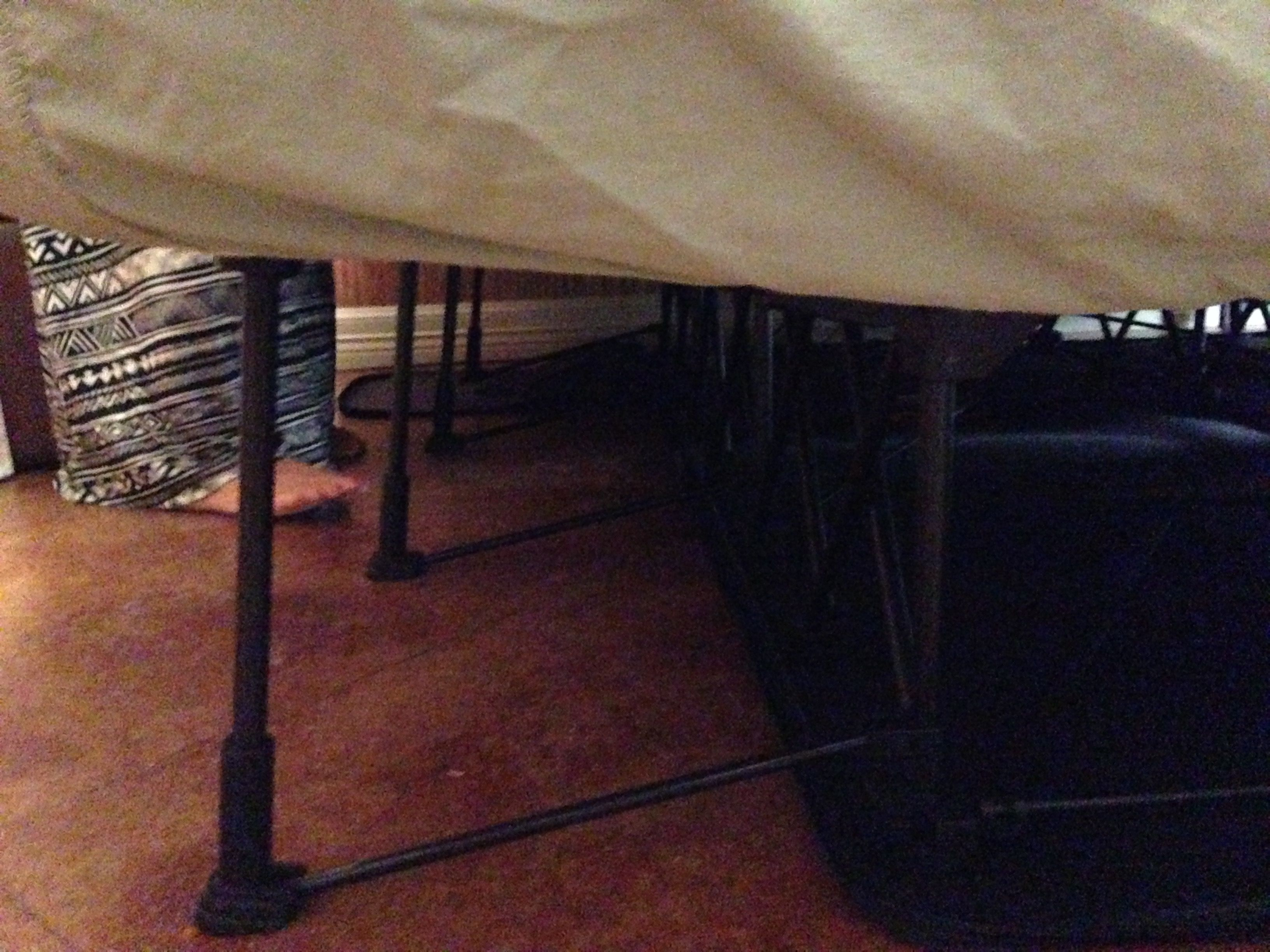 Fold up blowup mattress on stand from front gate
