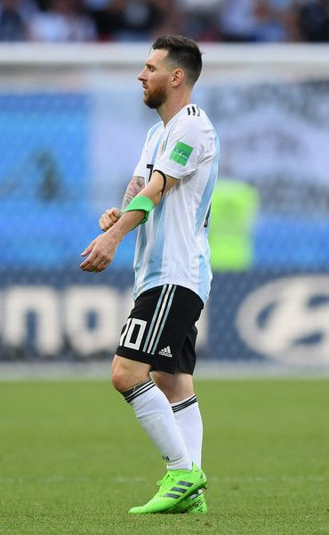 459700e4a Lionel Messi of Argentina removes his captain's armband as he leaves the  pitch following the 2018