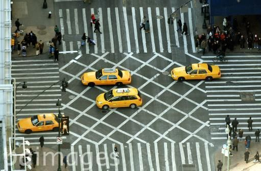 The view from the top of the Empire State building, as yellow taxis work their way through traffic in midtown Manhattan New York City.