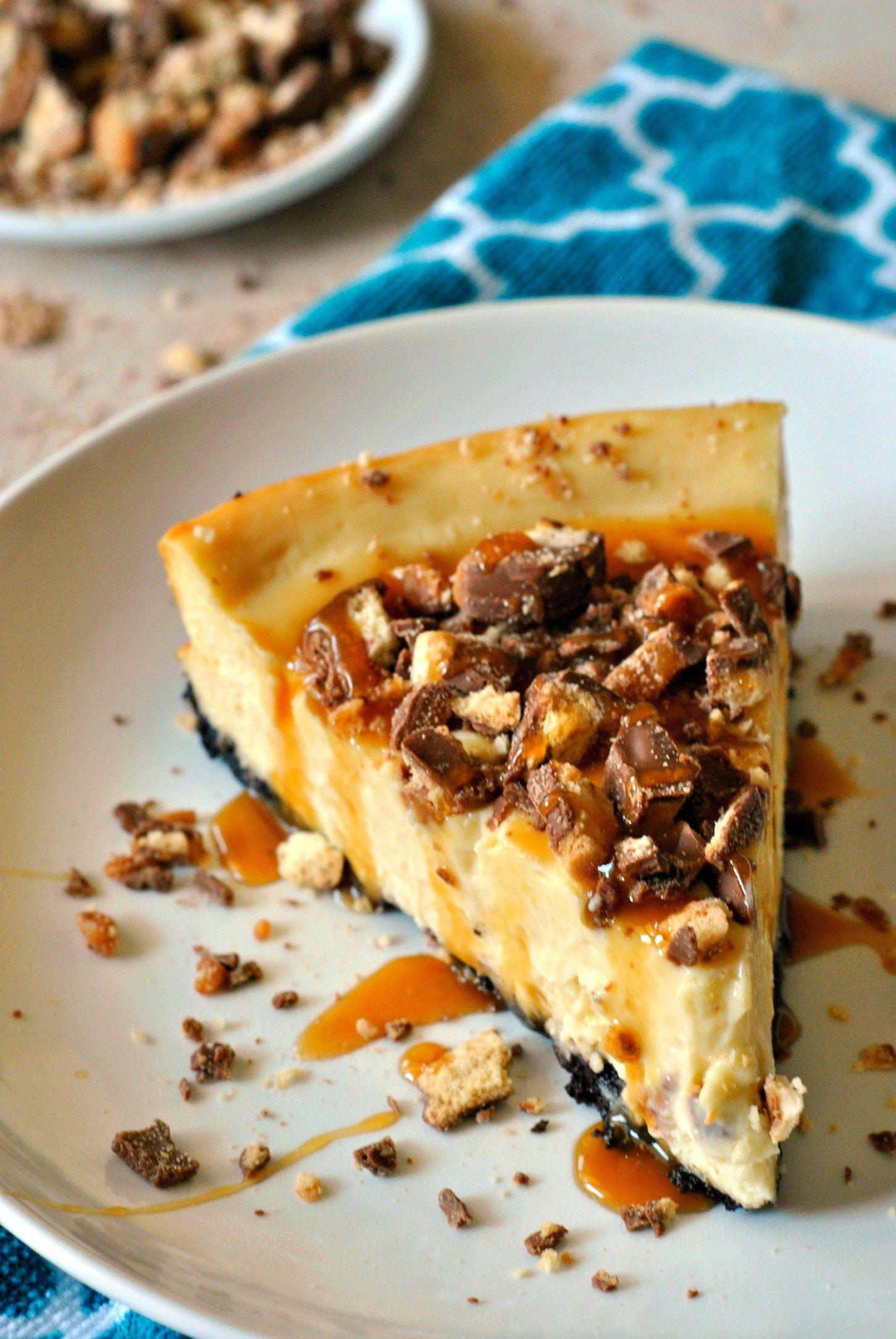 Chocolate oreo crust smooth cheesecake chopped twix bars