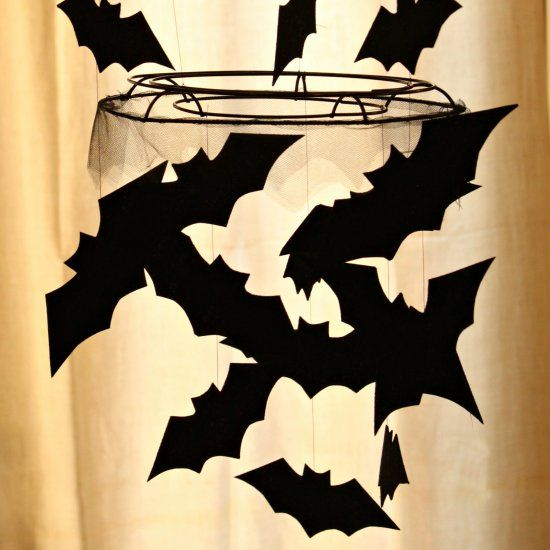 Make your own version of a pricy designer inspired bat chandelier - halloween decorations to make on your own