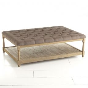 Our Pintuck Coffee Table Is A Great Solution With Its Dark Taupe Upholstered Top Column Legs And Plank Bottom Shelf
