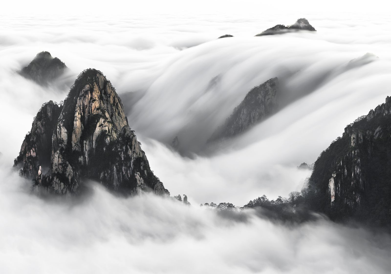 Picture of a mountain peak above thick cloud cover, China