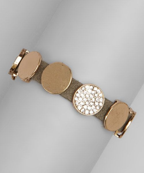 Dazzle up the wrist with this chic bracelet. With faux leather and shining accents, it sets the scene for a funky, fashionable ensemble.0.4'' W x 8.5'' LPolyurethaneImported
