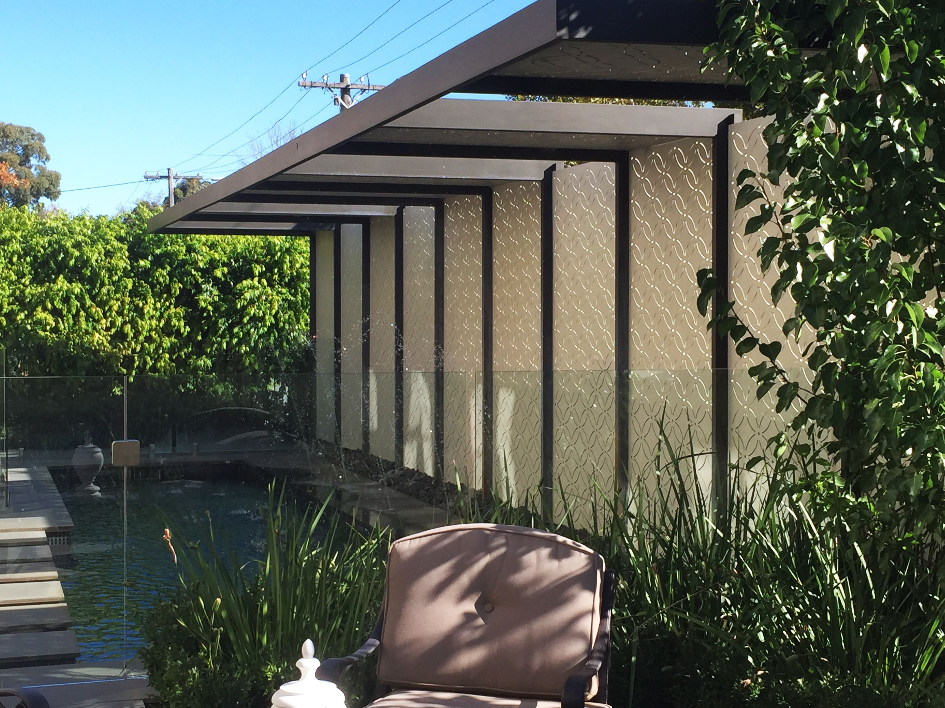 A privacy screen shields a lap pool from the street and for Pool privacy screen