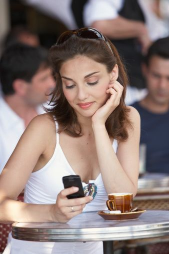 France Paris Young Woman Looking At Mobile Phone In Cafe Stock Photo 200441377-001