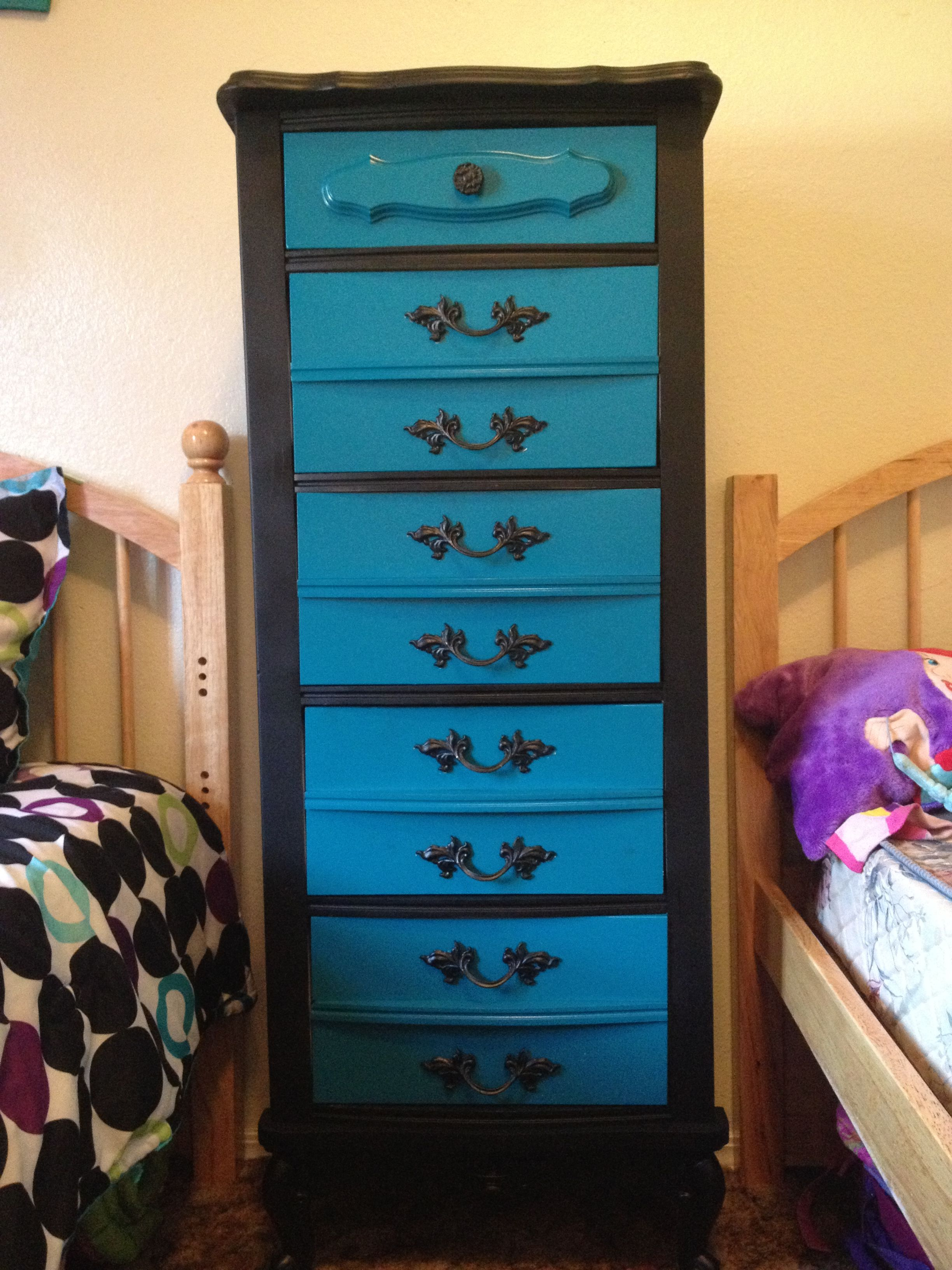 Repurposed dresser...in the girls room! Love the bright turquoise and black together!