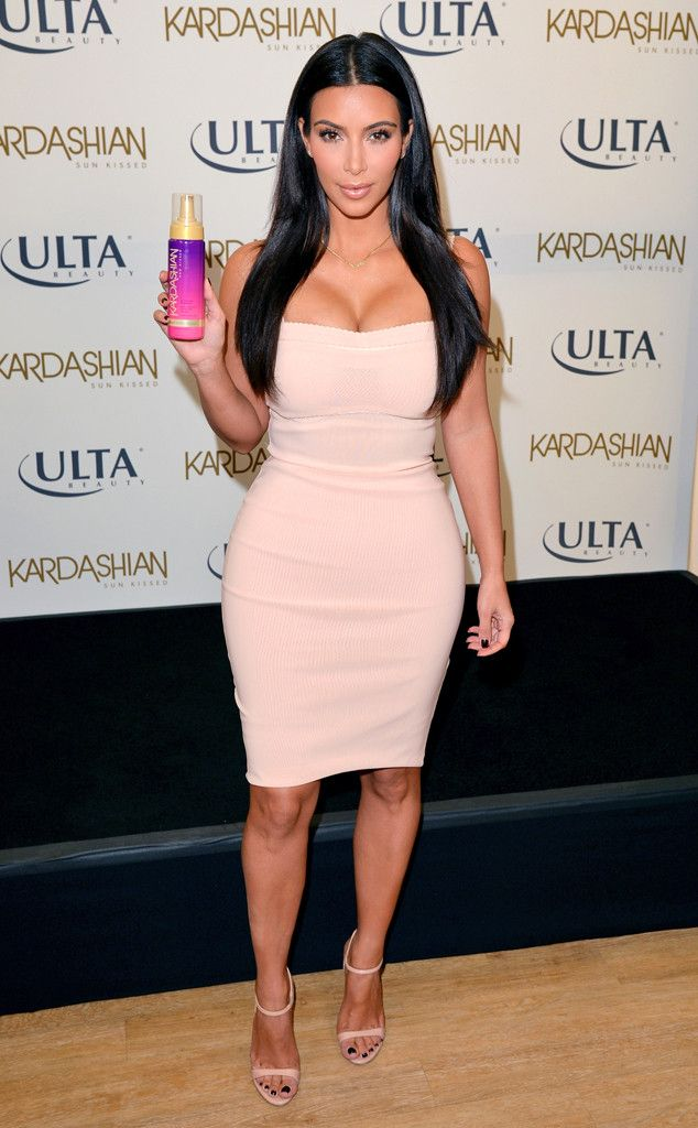 Kim Kardashian Shows Off Major Cleavage in Sexy Strapless Dress—See ...