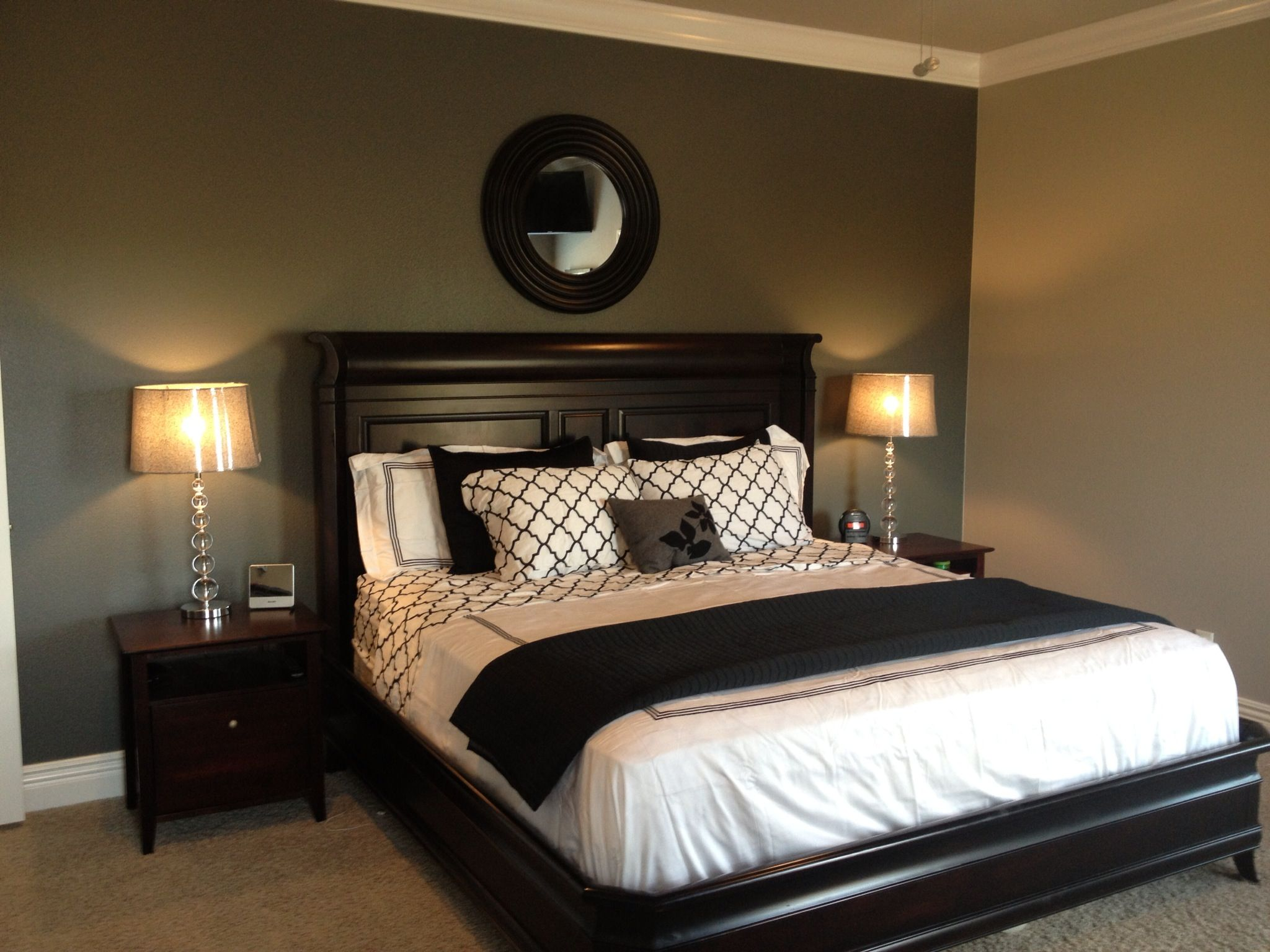 black painted bedroom grey accent wall with black and white bedding lamps 10867