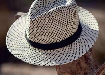 This Fedora hat by John Lewis is a simple contrast chequered design with a black band around the head. Wear it on hot summer days for a cool and sophisticated look.
