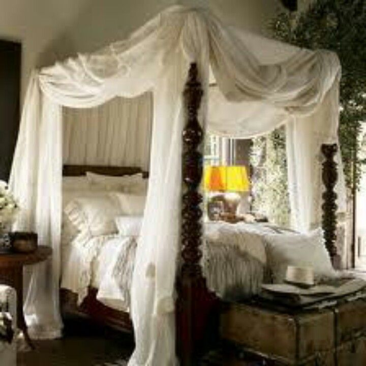 Dark Wood Carved Four Poster Bed