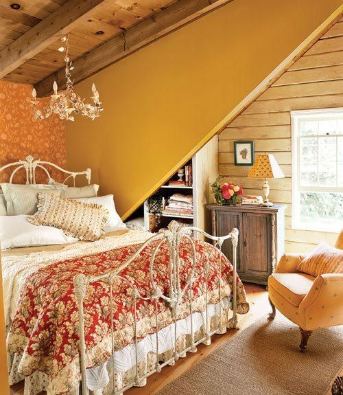 I love the white rod iron headboard and the layered quilt on white