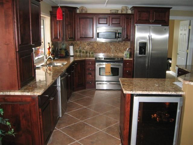 What color cabinets with black and stainless steel appliances google search remolding Kitchen design mahogany cabinets