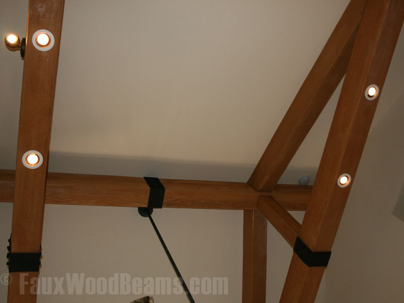 Faux wood beams are hollow so it's easy to install track