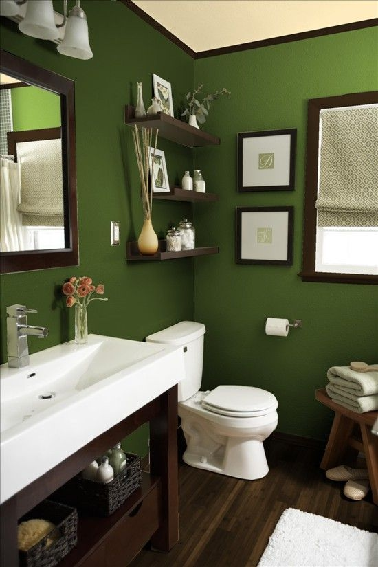 A Deep Green And Wood Accents Makes This Bathroom Feel