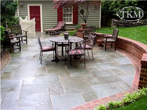 Mortared Flagstone Patio with brick borders and seat wall