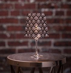 LeLe | Wine Glass Shades fit over any standard 12-16 oz (sometimes up to 18oz) wine glass to bring instant elegance to any dinner table, event, wedding or party. Simply drop in the water-activated floating LED candle & enjoy!  Includes 4 shades & 4 candles.  Expandables.ca
