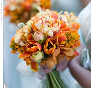 A hand-tied bouquet of flame and mango mini calla lilies and Sunkist orchids added a burst of color to Charity's gown.