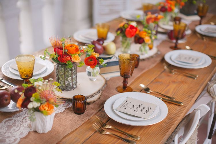 Goblets, small vases of flowers, and plentiful fruit create an air of fall festivenesson this lace-accented tablescape. Via Nicole George Event Planning & Design