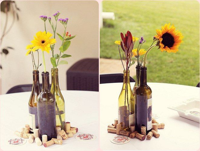 Wine bottle vases and corks make a really classy and Wine bottle wedding centerpieces