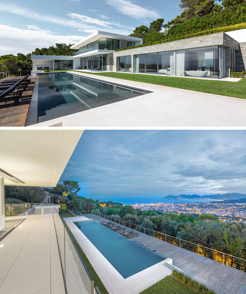 This New Home Is Nestled Into The Hillside Overlooking The City Of