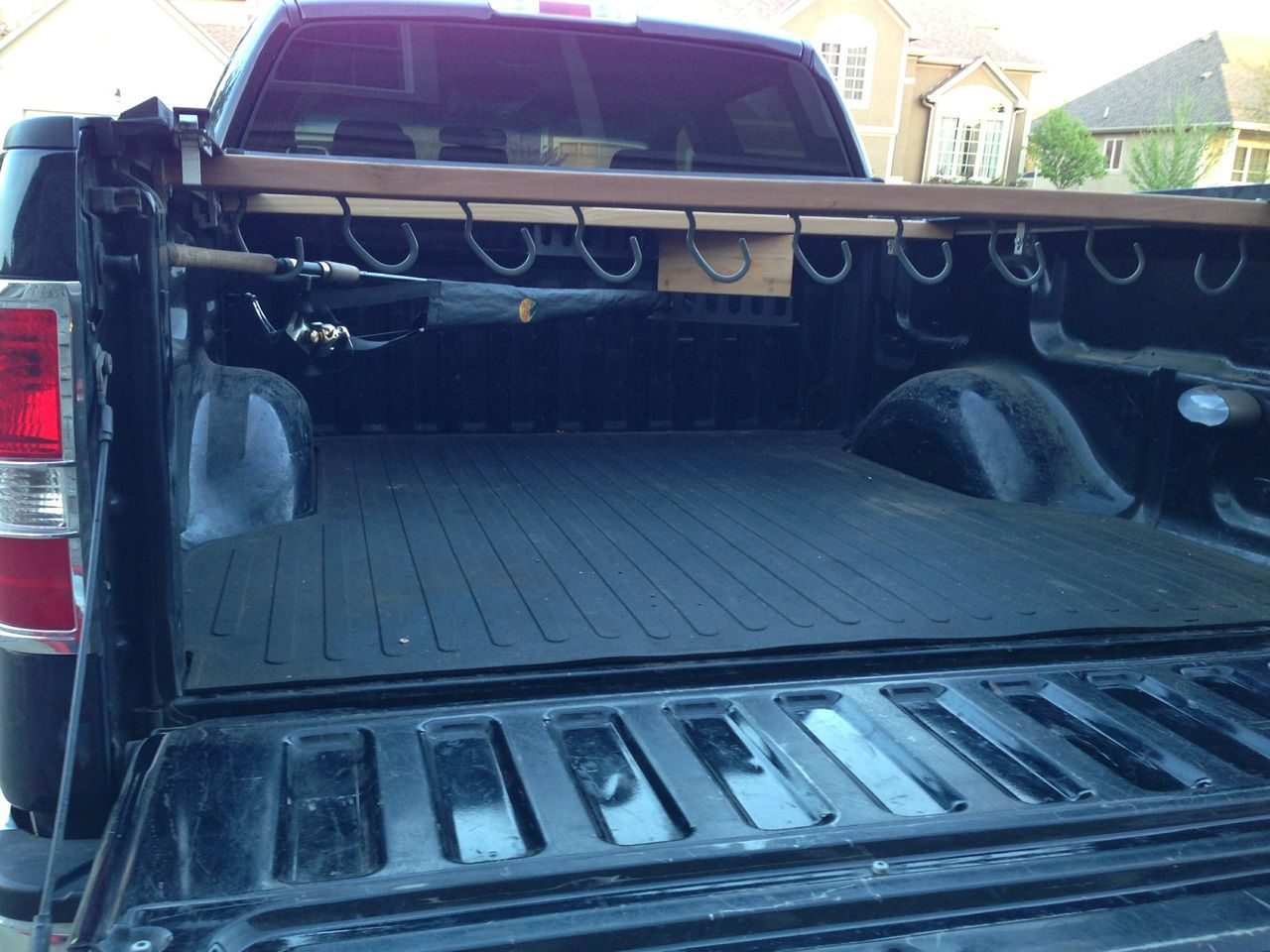 Diy fishing rod holder and pole rack for 5 foot truck bed for Truck bed fishing rod holder