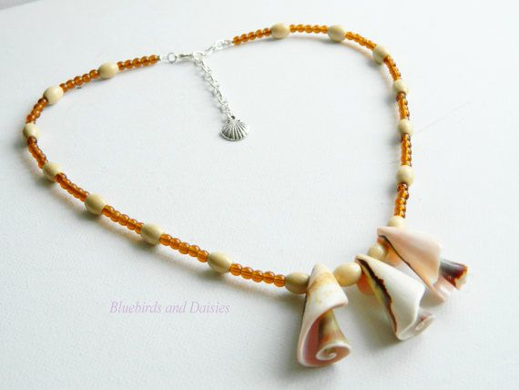 Shell Necklace with Wood and Glass Beads by Bluebirdsanddaisies, £10.50