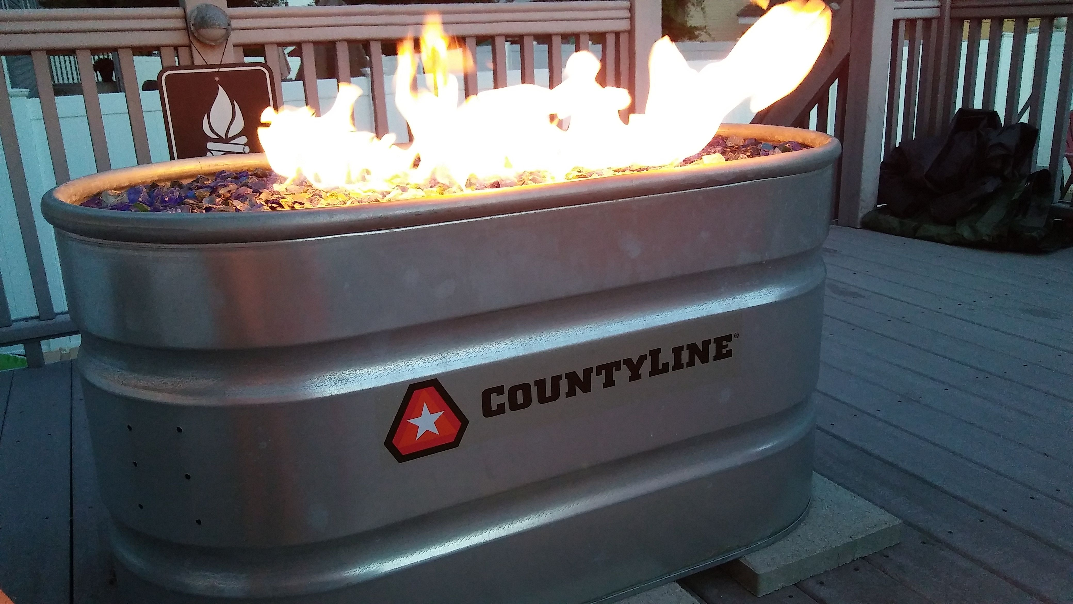 use a stock tank to make a diy outdoor fire pit beautiful