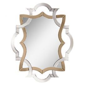 """Wall mirror with an openwork Baroque-inspired frame. Product: Wall mirror Construction Material: Mirrored glass Color: Gold and silver frame Features: Baroque-inspired Two-toned palette Dimensions: 41.75"""" H x 32.75"""" W"""