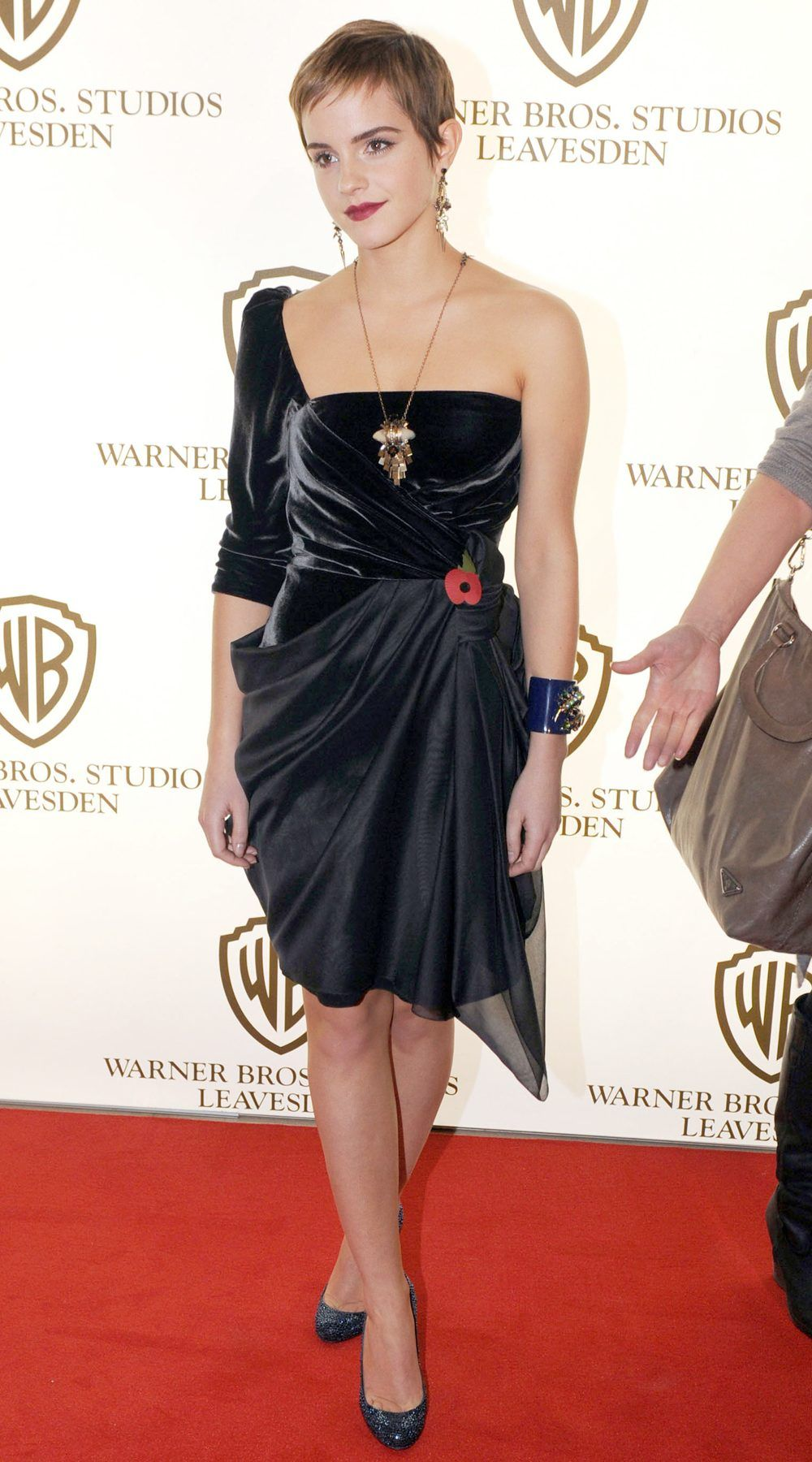 Can you believe how much Emma Watson's style has changed over time photo