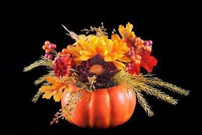 Google Image Result for http://us.123rf.com/400wm/400/400/darren/darren0910/darren091000024/5742433-autumn-flower-arrangement-put-in-a-pumpkin-on-a-black-background.jpg