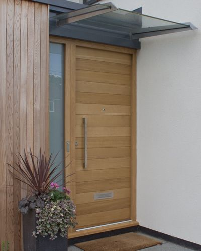 Modern Exterior Of Home With Pathway Transom Window: Contemporary Wood Front Door With Opaque Glass Window