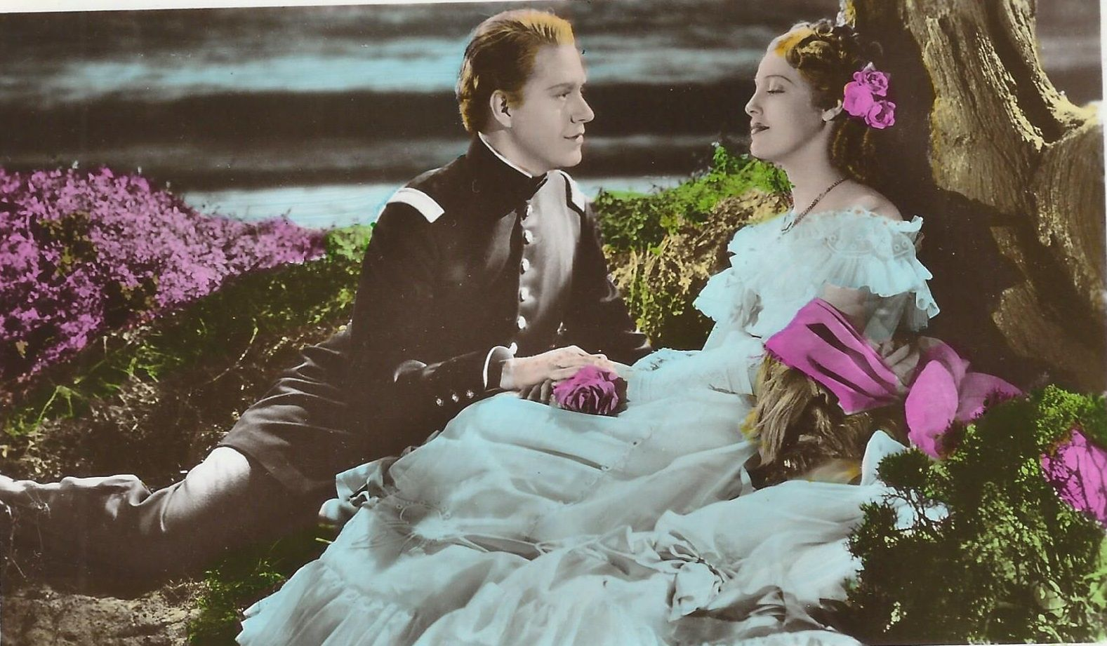 """Jeanette MacDonald and Nelson Eddy on a color postcard from The Girl of the Golden West. Back of the PC states: """" Film Partners Series. No. PC 253. This is a Handcoloured Real Photograph"""" - ESCANO COLLECTION"""