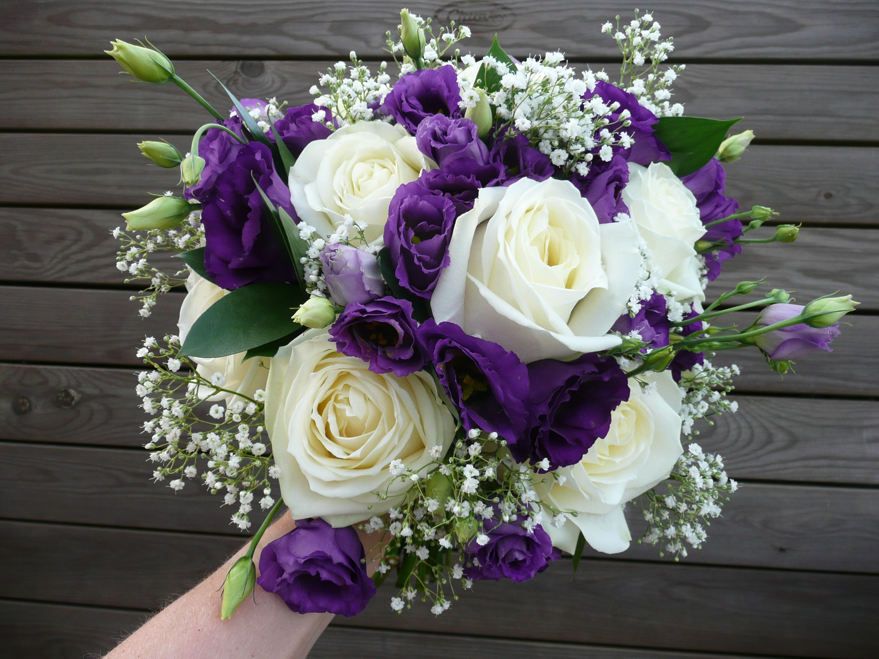Large white rose, purple lisianthus, gypsophila and ruscus