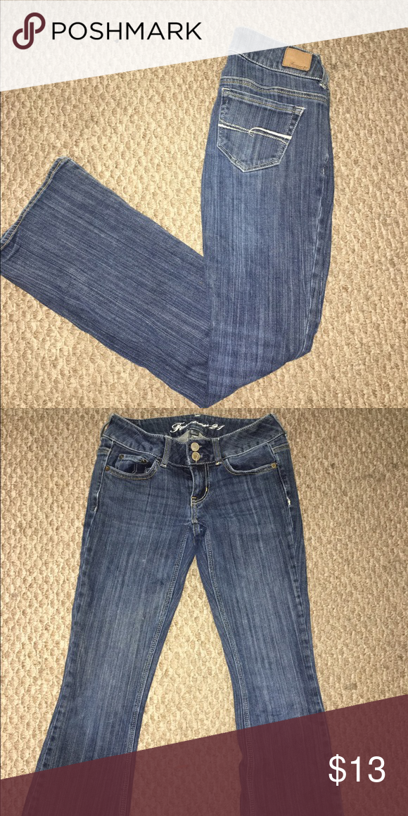 Low-rise jeans SO cute, my favorite jeans, too small for me now. Tight around the thigh & flows out like a boot cut by the shin!! Forever 21 Jeans Boot Cut