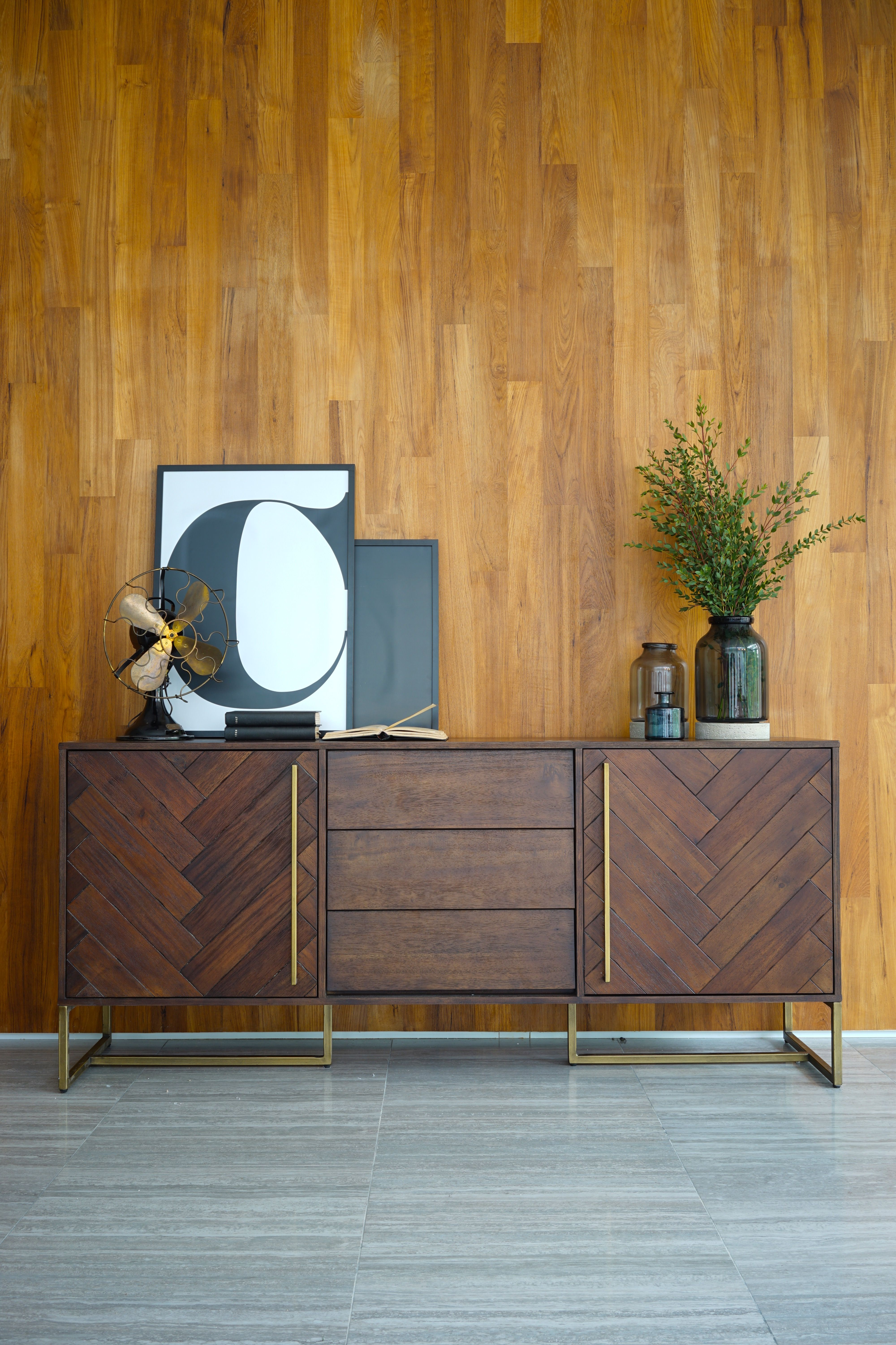 What better way to get organised than with the quality modern vintage bruno sideboard with its distinctive herringbone pattern laid in acacia wood