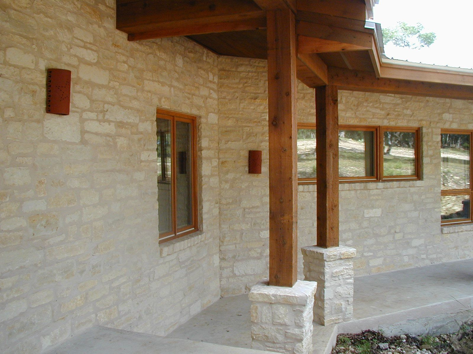 Texas hill country house color schemes exterior house for Hill country stone