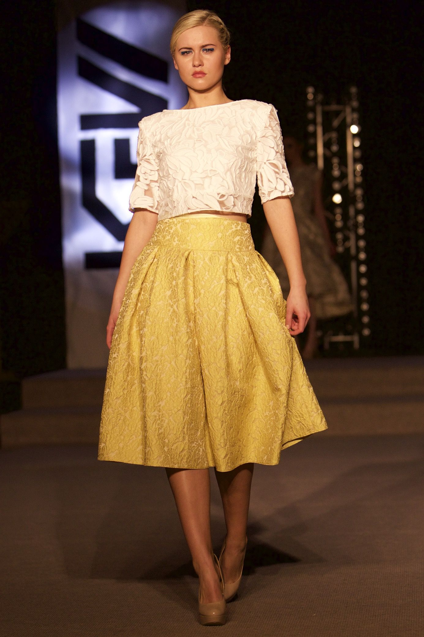 Yellow Brocade box pleat skirt and raised white backless top from Tina Griffin 2015 Collection. www.tinagriffin.ie