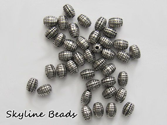 Fun Oval Shape Tibetan Style Beads, Antique Silver, 7mm x 5mm - Barrel look by SkylineBeads on Etsy