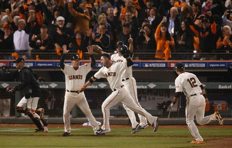 Description of . Giants' Travis Ishikawa(45) celebrates his walk-off home run in the bottom of the ninth inning to win Game 5 of the National League baseball championship series against the St. Louis Cardinals at AT&T Park in San Francisco, Calif., on Thursday, Oct. 16, 2014. (D. Ross Cameron/Bay Area News Group)