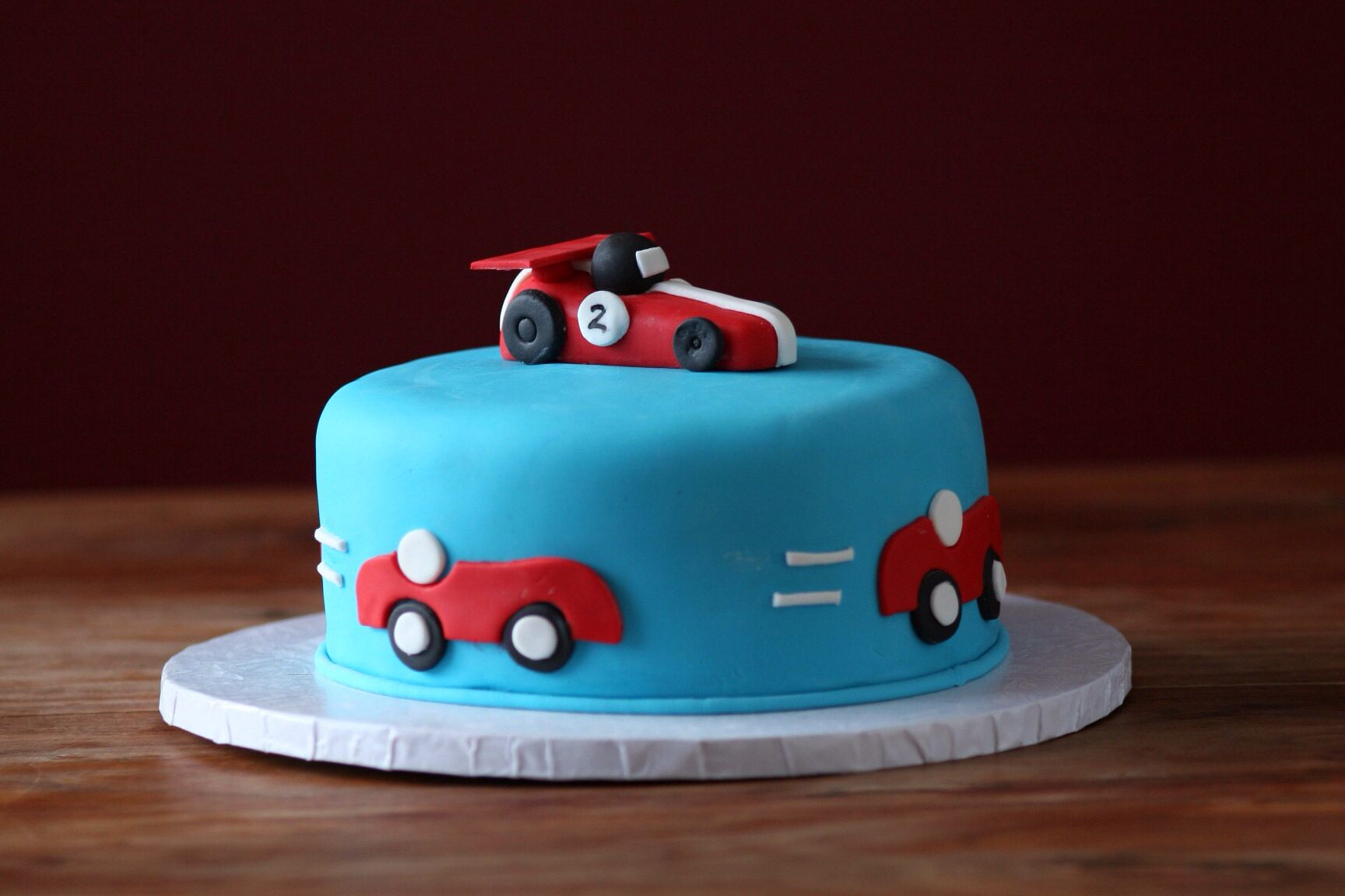 Racing car themed birthday cake for a 2 year old little