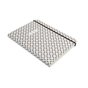 caroline gardner sophisticated geometric print mid notebook, its inner cover is lined with pretty mustard and white stripes, 140g ruled paper with approx 104 pages, and an elasticised closure. great notebook to use for work, school or carry around with you for those all- important ideas.