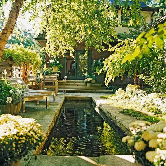 An 18-inch-deep reflecting pool makes this outdoor space stand out. More dream water #gardens from @Better Homes and Gardens